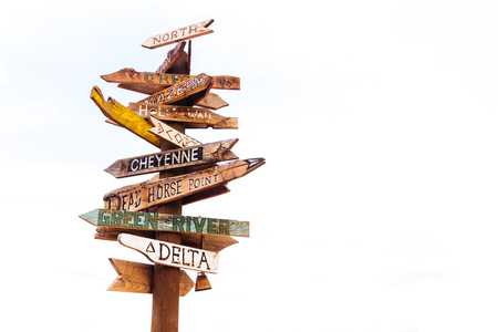 Isolated Traffic signs and directional signpost pointing to famous tourist destinations in Utah with cloudy sky sky and free copy space for text