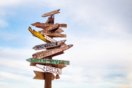 Traffic signs and directional signpost pointing to famous tourist destinations in Utah with cloudy sky sky and free copy space for text Stock Photo