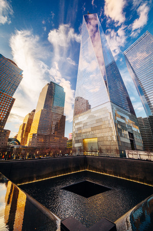 Ground Zero Memorial with One World Trade Center in the background in New York City Stock Photo