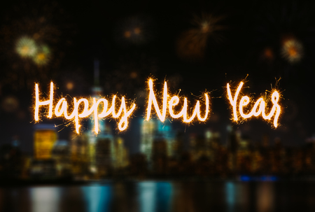 Happy New Year Handwriting Lettering with blurred background of New York City Lower Manhattan