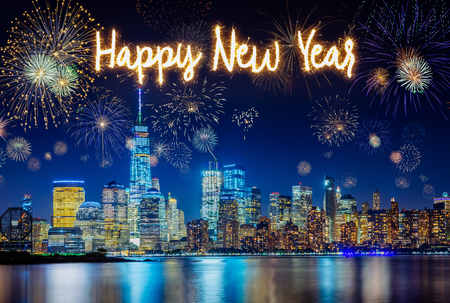 New York City Skyline with Flashing Fireworks celebration of new years eve with happy new year handwriting 스톡 콘텐츠