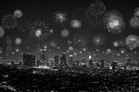 Black and white Downtown Los Angeles cityscape with flashing fireworks celebrating New Years Eve. Stock Photo