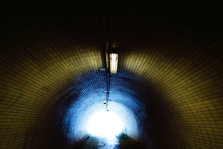 Blue Light at the End of a Tunnel Stock Photo