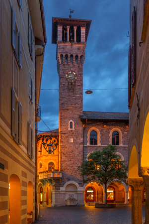 Palazzo Civico in Bellinzona, Switzerland during early night with blue sky and street lights, long exposure Stock Photo