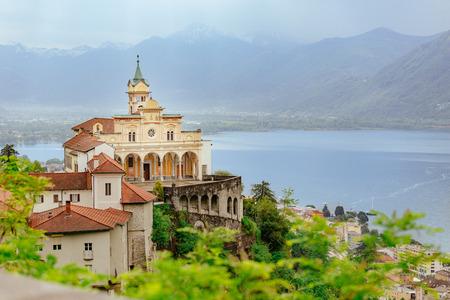 Madonna del Sasso Church directly above the Maggiore lake  and city of Locarno,  in Ticino, Switzerland