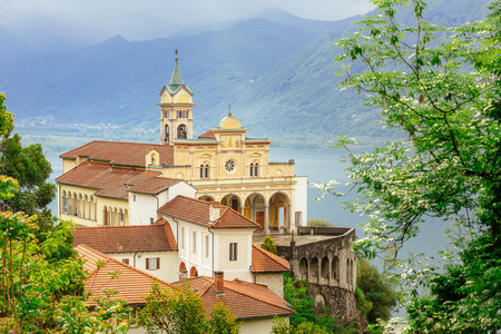 Madonna del Sasso Church directly above the Maggiore lake  and city of Locarno,  in Ticino, Switzerland