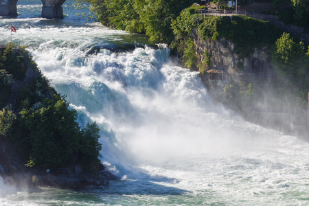 Rhine Falls is the largest waterafall in Europe and a big tourist attraction. The falls are situated on the High Rhine, on borders of cantons of Schaffhausen and Zürich next to Schaffhausen, in northern Switzerland