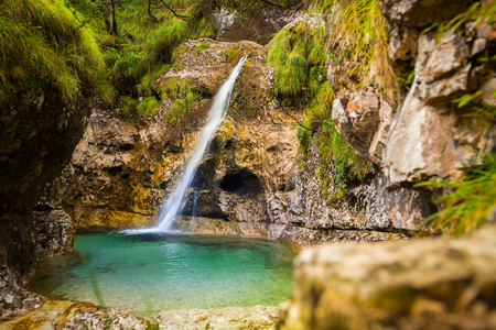 Cadini of Brenton, Sospirolo, Italy with azure clear water and multiple waterfalls along the way down