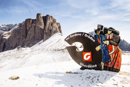 Val Gardena Statue with Passo Gardena mountains in the background Editorial