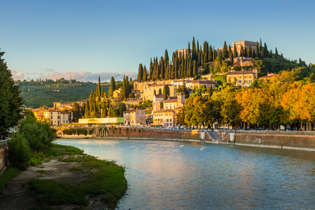Verona cityscape during late sunset with Adige river and Church Complesso della Cattedrale-Duomo. Verona is located in Veneto, Italy,