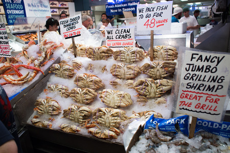 Seattle, Washington, USA - May 4, 2018: Pike Place Fish Market - famous market in Seattle where people can get a wide selection of fresh sea fishes every day Editorial