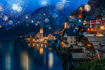 Hallstatt in Austria celebrating New Years Eve with flashing colorful fireworks Stock Photo