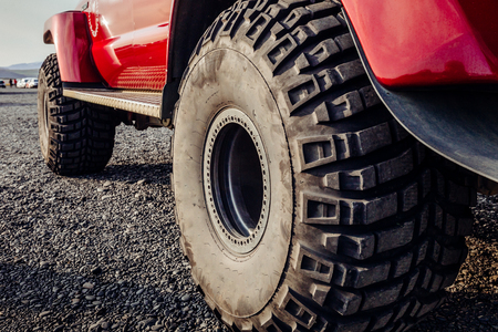 Detail of a black offroad tire on a offroad truck vehicle, built for heavy rides and unpaved roads Stock Photo