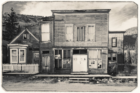 Black and White Sepia Vintage Photo of Old Western Wooden post office or saloon in St. Elmo Gold Mine Ghost Town in Colorado, USA hidden in mountains Editorial