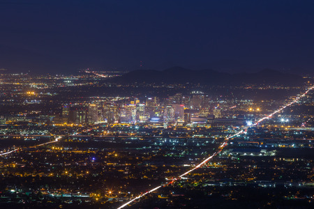 Panoramic view of night Phoenix skyline with glowing lights from Dobbins Lookout