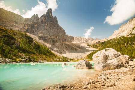 Lake Lago di Sorapis, Dolomites, Italy with blue sky, azure water and high mountains in the background Stock Photo