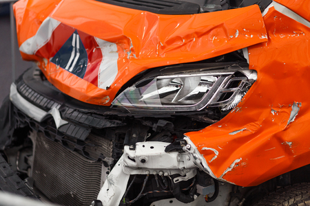 Detail of damaged car chasis after dangerous car crash with torn and wringled metal all over the accident