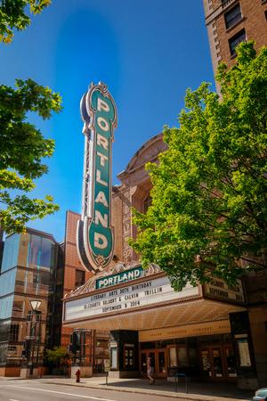 Downtown Portland, Oregon, USA - July 24, 2019: Arlene Schnitzer Concert Hall with wonderful street sign Portland on a sunny day, in Portland, Oregon, USA