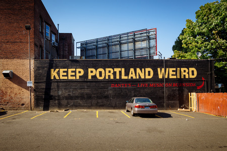 Downtown Portland, Oregon, USA - August 3, 2018: Keep Portland Weird Street Lettering Sign to promote local business. The slogan has been called the unofficial motto of Portland