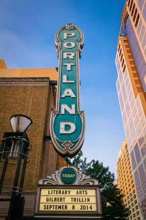 Downtown Portland, Oregon, USA - September 8, 2014: Arlene Schnitzer Concert Hall with wonderful street sign Portland on a sunny day, in Portland, Oregon, USA