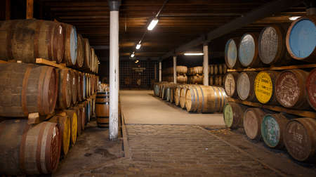 Seafield Ave, Keith, Scotland, UK - July 30, 2019: Old Oak Barrels full of good whiskey from various distilleries in a whiskey cellar Editorial