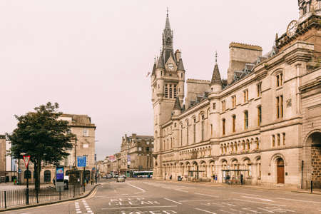 Aberdeen, Scotland - 31 July, 2019: Union Street with daily car traffic in Downtown Aberdeen City Centre with Aberdeen Town House, in Scotland, UK Editorial