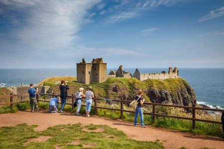 Dunnottar Castle, Scotland, Stonehaven, Aberdeenshire, Scotland, - 31 July, 2019: Beautiful Exterior of Dunnottar Castle with tourists