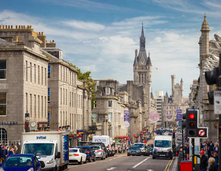 July 31, 2019: Aberdeen, Scotland, UK - Union Street with daily car traffic in Downtown Aberdeen City Centre with Aberdeen Town House, in Scotland, UK