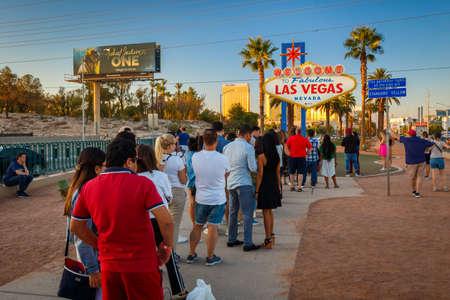Las Vegas, Nevada, USA - October 15, 2019: Famous Las Vegas Sign on Las Vegas Boulevard surrounded by long line of tourists Editorial