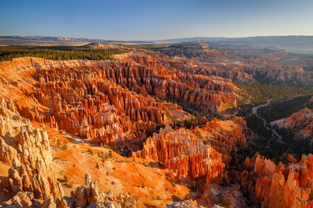 Inspiration Point during beautiful sunrise, with hoodoos - unique rock formations from sandstone made by geological erosion. Bryce National Park, Nevada, USA