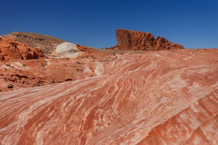 Surrounding landscapes of Fire wave during wonderful sunny day with blue sky, in Valley of Fire State Park, Nevada, USA