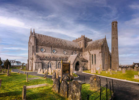St Canice's cathedral and cemetery in Kilkenny, Ireland, Europe, during sunny day with blue sky and clear blank space for text copy