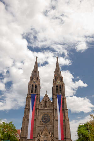 Church of saint Ludmila on Namesti Miru (Peace Square) with Czech flags, in Prague, Czech Republic (Czechia), Europe Banco de Imagens