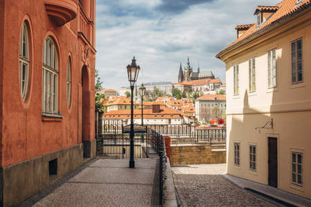 Prague Castle between buildings in a street of Prague, during wonderful sunny day with blue sky