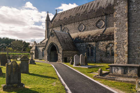 St Canice's cathedral and cemetery in Kilkenny, Ireland, Europe during sunny day with blue sksy Editorial