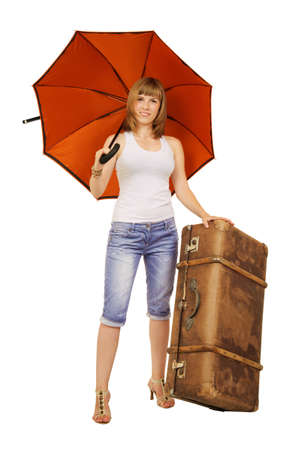 Smiling young lady with an orange umbrella and an old brown leather suitecase Stock Photo - 12827026