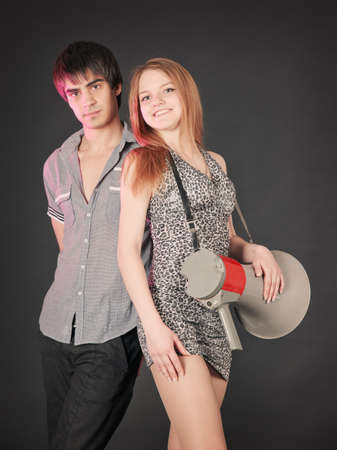fashion young  caucasian couple, studio shot on black background photo
