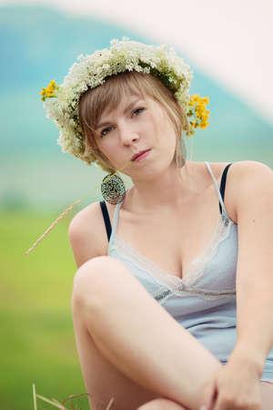 Pretty farm lady sitting on a haystack Stock Photo - 13006607