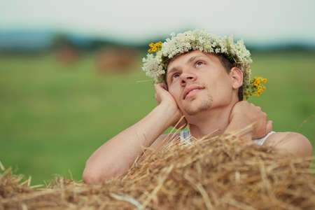 cute guy: cute guy with a romantic look near haystack
