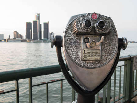 downtown: Detroit Sightseeing from Windsor. Sightseeing tourist binoculars overlooking downtown Detroit, Michigan on a summer afternoon from Windsor, Ontario, Canada.