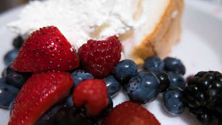 shortcake: Fruit Shortcake American. Shortcake with strawberries, blueberries, raspberries, blackberries and whipped cream. 4th of July, red white and blue American style.