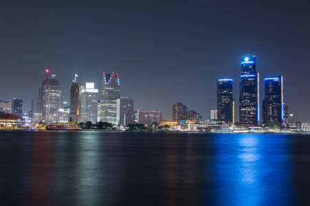 michigan: Detroit at Night Color. Downtown Detroit, Michigan as seen from across the Detroit river in Windsor, Canada. Shot late at night.