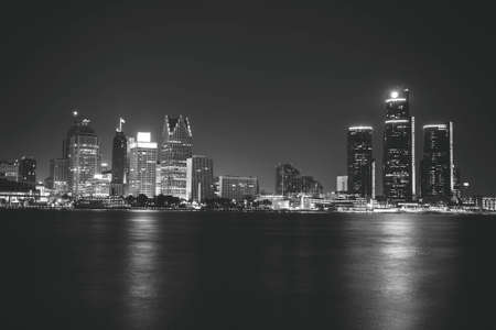 downtown: Detroit at Night Black and White. Downtown Detroit, Michigan as seen from across the Detroit river in Windsor, Canada. Shot late at night and carefully edited in black and white.
