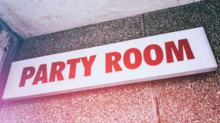 party room: Party Room Sign. A sign indicating where a party room is located.