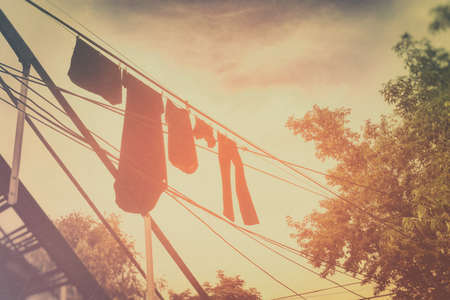 air dried: Clothesline Afternoon Glow. Clothesline on a warm summer afternoon. Edited in vintage style.