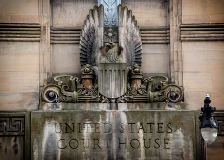 supreme court: United States Court House. United States Court House sign and statue at the entrance to a Buffalo, New York location. Editorial