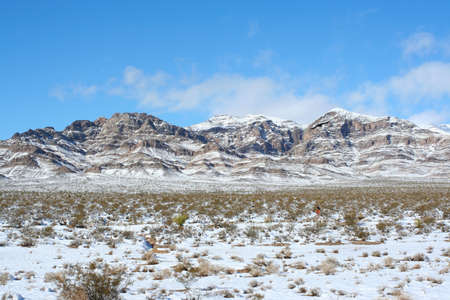 15 18: Nevada Mountains Along Highway 15. Snow capped mountain tops as seen along US interstate 15, between Jean and Primm, Nevada. Shot the morning after a rare blizzard hit the area December, 18, 2008.