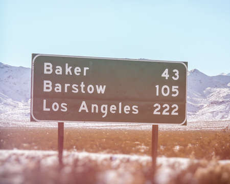 barstow: California Road Sign Los Angeles Baker Barstow. California highway sign showing mileage to the cities of Baker, Barstow and Los Angeles. Shot in the Mohave Desert along interstate highway 15. Editorial