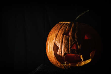 jack o' lantern: Jack O Lantern Dark Room. Classic jack o lantern in a very dark room.