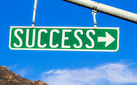 street sign: Success Street Sign. A sign with the word Success printed on it. Stock Photo